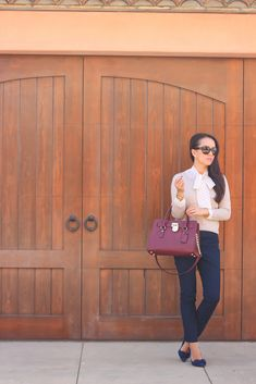 Beige sweater, navy Sloan pants, polka dot tie neck blouse, Chanel sunglasses, burgundy tote, bow pumps  //  Click the following link to see all photos and details:  http://www.stylishpetite.com/2014/10/burgundy-bag-and-michael-kors-favorites.html