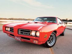 1969 Carousel Red Pontiac GTO-my dad wasso lucky! This was his car in highschool! Omg