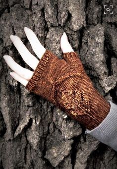 I always wear fingerless gloves. I love the idea of doing this for a photo --   http://www.yarn.com/product/never-not-knitting-oak-grove-pdf/