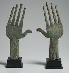 Etruscan bronze hands from the Tomb of the Bronze Chariot at Vulci, The Villa Giulia, Rome. c. 650 B.C.E.