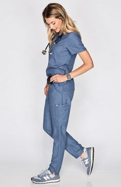 Why We Love This Polish your professional look with our most stylin' scrub pant yet. A tapered, skinny fit offers a contoured silhouette, equipped with our sign Scrubs Outfit, Scrubs Uniform, Medical Scrubs, Nursing Scrubs, Stylish Scrubs, Nursing Clothes, Nursing Shoes, Cute Scrubs, Medical Uniforms