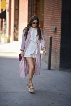 Paola Alberdi is rocking a super cute spring style in head to toe pastels! This white wrap around playsuit is light and flirty, and along with a pair of strappy platforms the blush pink trench just adds endless glamour to the look! Coat: Express, Playsuit: BB Dakota, Heels: Paloma Barcelo.