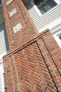 Nautically detailed red brick chimney - Degnan Design