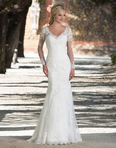Sincerity wedding dress style 3898 |Illusion lace and tulle long sleeve fit and flare gown featuring a V-neckline with floating lace and a scalloped hem create this graceful gown.