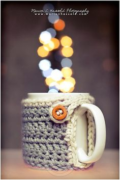"FREE mug warmer cozy pattern on ravelry.com!!  Note from the designer: ""i forgot something important:  Please, crochet 2 chains less in round 3 so there is place enough for the mugholder! so if your foundation chain was 27, you now have 25 dc's."""