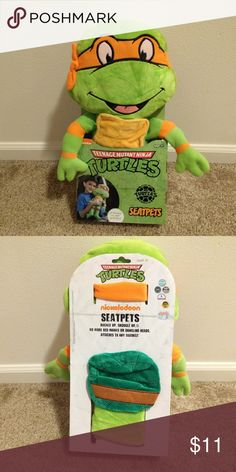"SeatPet Teenage Mutant Ninja Turtle Brand new SeatPet Ninja Turtle   Easily attaches to any seat belt for fun and comfort!  Perfect for play time, relaxing, or naps  Teenage Mutant Ninja Turtle Michelangelo measures 18"" in height  Machine wash; tumble dry low  Velcro for easy fastening! Nickelodeon Other"