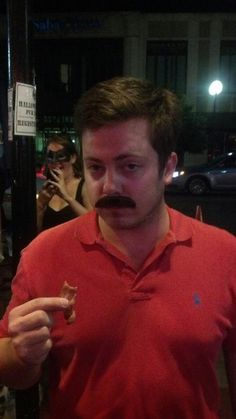 I want this to be my halloween costume this year . Ron Swanson eating bacon at the bars.