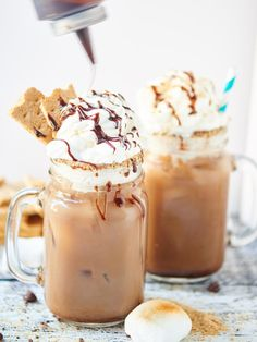 This S'Mores Iced Coffee is creamy, chocolatey, filled with marshmallow fluff and has a fun chocolate and graham cracker rim! It's a caffeinated S'Mores in a glass! showmetheyummy.com #smores #chocolate #coffee #dessert #breakfast #marshmallow