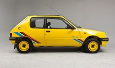 Peugeot Rallye. 20+ year-old euro hot hatch. Love this old school style. yellow on yellow.