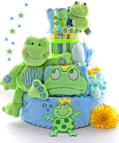 Friendly Frogs 3 Tier Diaper Cake  (now that I know whats in it I could totally make this )    35 Disposable Diapers,  Plush Frog by Gund,  Frog Bottle Holder,  Appliqued Hooded Towel,  Johnson's Baby Lotion,  Johnson's Baby Bath,  Johnson's Baby Powder,  Johnson's Baby Shampoo,  Desitin Diaper Cream,  Johnson's Soothing Naturals  Bath Mitt,  3 Washcloths,  Scratch Mittens,  Fork & Spoon Set,  Pacifier Clip,  Pacifier,  Booties and  Manicure Set...yeah, I can do this!