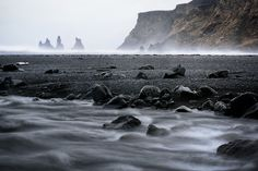FerGarciaPhoto posted a photo:  The picture can't reflect the wind-speeds of that day at Reynisfjara black beach in Vík, Iceland. I can't remember the 'actual number' but I barely could stay upright. Getting here was kind of scary too: the car just kept swaying away because of the wind pushing it out of the road.  But all of us have seen this postcard and I wanted to capture it too. So, I practically crawled looking for a nice spot that captured the mood (since then I'm in love of shooting…