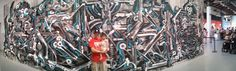 Daddy & his girl in front of some industrial graff
