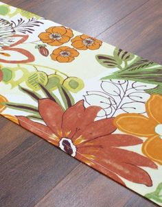 """Lilith Collection Table Runner, TABLE RUNNER, 12.5x54""""X, LILITH MARIGOLD by Home Decorators Collection. $24.00. Hemmed Table Runners – 12""""H x 36""""W; 12.5""""H x 54""""W; 12.5""""H x 72""""W.. With a colorful collection finished with texture and beautiful detailing, our Lilith Collection Table Runners will complete the look of any dining room. We have made decorating easy for you by coordinating a family of four fabrics that look good individually and even better when pai..."""