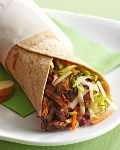 Shredded roast beef makes delicious leftovers you can savor all week. For these simple wraps, dress the meat in a dollop of tangy barbecue sauce, then roll it up with shredded cheese and crispy slaw to create one of our easiest healthy lunches to pack for work. #lunchrecipes #lunchideas #easylunchideas #bhg Healthy Packed Lunches, Cold Lunches, Make Ahead Lunches, Healthy Lunches, Brown Bag Lunches, Lunch Recipes, Sandwich Recipes, Easy Recipes, Beef Wraps