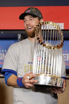 World Series MVP Ben Zobrist of the Chicago Cubs poses with The Commissioner's Trophy after the Chicago Cubs defeated the Cleveland Indians in Game Seven of the 2016 World Series at Progressive. Get premium, high resolution news photos at Getty Images First World Series, Chicago Cubs World Series, Chicago Cubs Baseball, Tigers Baseball, Cleveland Indians Game, Cleveland Ohio, Ben Zobrist, Baseball Helmet, Cubs Win