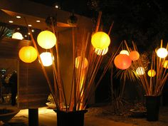 i could totally pull this off with bamboo rods and paper lanterns...both of which you can buy at dollar tree i might add!