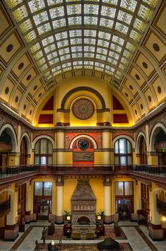 Union Station restored 19th-Century railroad station Hotel, Resturant National Landmark 65 ft, ceiling, gold-leaf medallions 100-yr-old, original Luminous Prism stained glass •Marble floors, oak-doors and walls, 3 limestone fireplaces  •20 gold-accented angel of commerce figurines - a steam locomotive and horse-drawn chariot - at each end of the lobby architecture structure