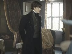 Sam Riley as Mr.Darcy. He is very used to being beaten by a woman.  I love how he dodge the books... It makes me wonder...