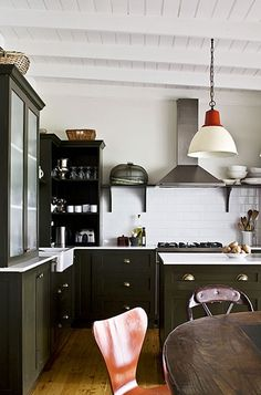 I love this kitchen.  Especially the painted cabinets and brass fixtures.