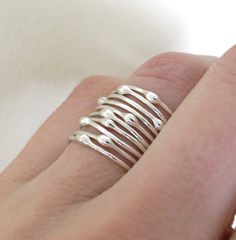These sterling-silver rings are so delicate individually, but stacked together they make a big statement.