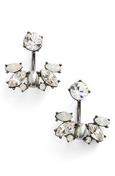 A medley of sparkling crystals add classic elegance to au courant ear jackets designed to frame the ear in multidimensional shine. So cute!