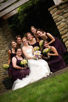Mrs. Snow Cone poses with her bridesmaids, who wore knee-length purple chiffon dresses by Belsoie