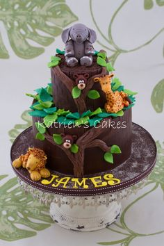 Safari Cake Chocolate mud cake with modeling chocolate collars and leaves, as well as gum paste safari animals. Chocolate Mud Cake, Modeling Chocolate, Fondant Cakes, Cupcake Cakes, Cupcakes, Jungle Cake, Jungle Party, Safari Party, Africa Cake