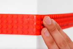 design studio nimuno has come up with a LEGO compatible tape that is flexible and cuttable, and features re-useable adhesive backing.