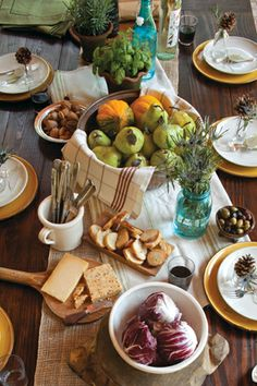 Thanksgiving & Autumn Tablescape with stoneware, copper, burlap and seasonal produce.