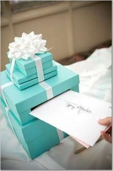 Tiffany Blue money box:  Search eBay for real Tiffany boxes that you can stack and glue together, wrap with  a bow and cut a slit in the top for your money box.
