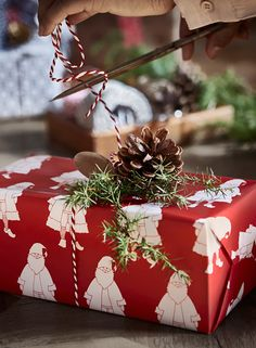 Put a pinecone on it! Check out this year's festive IKEA gift wrap ideas.