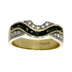 A green tourmaline and diamond multi-stone eternity ring consisting of green tourmalines channel set across top section of a yellow gold band and also diamonds in white gold grain settings either side.