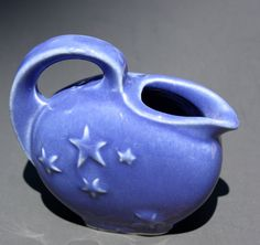 This little cobalt blue Shawnee Pottery pitcher with embossed stars is very collectible. It measures 2 tall, and it is marked USA. Blue Pottery, Mccoy Pottery, Vintage Pottery, Vintage Ceramic, Shawnee Pottery, Pottery Marks, Ceramic Pitcher, Vintage Planters, Pottery Making