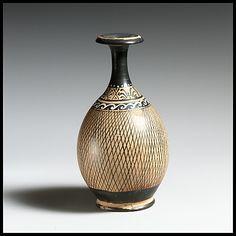 Bottle  Period: Late Classical Date: 4th century B.C. Culture: Greek, South Italian, Apulian Medium: Terracotta