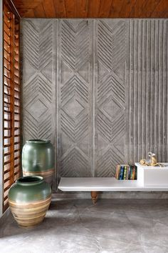 Deftly incorporating a double-height jali inside this three-floor bungalow in Vadodara, MS Design Studio lends it its aesthetic mojo Wall Panel Design, Wall Decor Design, Bg Design, House Design, Concrete Interiors, Grey Interiors, Estilo Interior, Interior Walls, Wall Cladding Interior