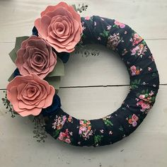 "This 14"" straw wreath form is wrapped in a beautiful navy blue and pink floral ribbon. It is adorned in large felt flowers in shades of pink and finished with smaller blue flowers, leaves and faux greenery. This wreath will brighten your front door and welcome guests to your home"