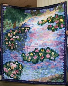 I do love Monet.  And this is a really cool hexie quilt.