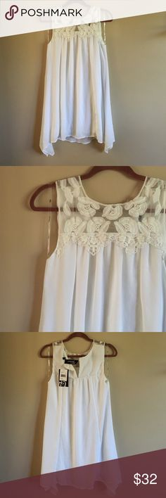 NWT White Dress Very, very cute dress! Bought it for work, but never ended up wearing it. I got it from Nordstroms + didn't realize the button was missing, (it comes w the replacement button) but I just never cared to sew it in! NOT FROM BRAND LISTED, it's from Trixxi Girl! Free People Dresses