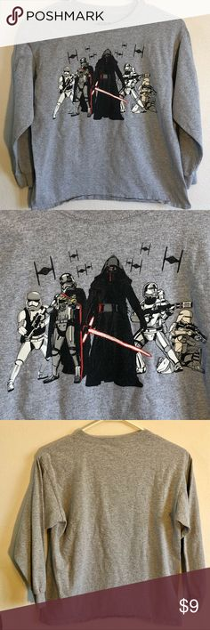 """Star Wars boys Sz. Large long sleeved Gray t-shirt Star Wars boys size large gray long sleeve T-shirt. Kylo Ren, Emperor Palpatine and Storm Troopers.  In very good used condition. No rips, stains or tears. Smoke free home.  Measurements (approx): 18"""" Pit to Pit. 17"""" Sleeve from shoulder seam to cuff. 22.5"""" long from top to bottom (front).  BUNDLE SPECIAL: 15% off 3 or more items from my closet! Star Wars Shirts & Tops Tees - Long Sleeve"""