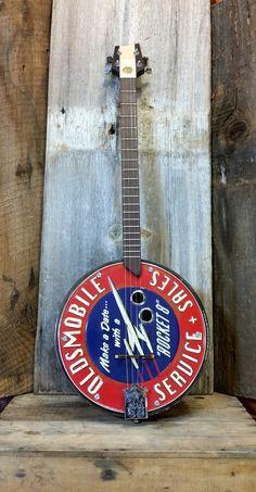 "C. B. Gitty Crafter Supply - Pontiac ""Service Sales"" Tin Sign Tenor Guitar/Banjo - 4-string Acoustic/Electric, $239.99 (http://www.cbgitty.com/cigar-box-guitars/pontiac-service-sales-tin-sign-tenor-guitar-banjo-4-string-acoustic-electric/)"