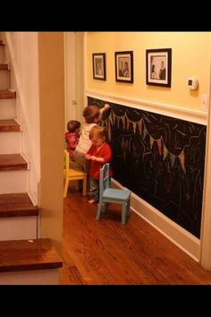 Buy some chalkboard paint and give the kiddies somewhere to be artistic. Just hope they don't draw on the other walls