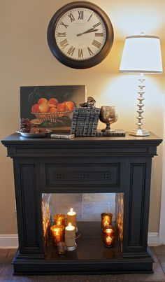 Faux Fireplace Makeover with mirrored back and pressed tin sides - great idea! Candles In Fireplace, Fake Fireplace, Bedroom Fireplace, Fireplace Surrounds, Unused Fireplace, Fireplace Moulding, Black Fireplace, Fireplace Mirror, Home Projects