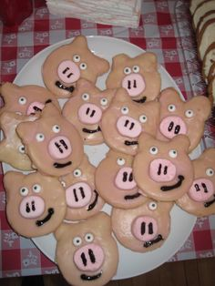 Pig cut out cookies for a Pig Roast. I cut strawberry large marshmallows into thirds for the nose and bought the candy eyes.