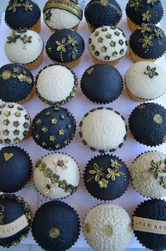 Black, gold, and white cupcakes