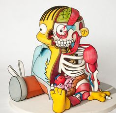 Courtenay, British Columbia-based designer Kylie Mangles of Freshly Squeez'd has created an awesome 3D cake portraying a half-dissected version of Ralph Wiggum from The Simpsons. It was built for T...