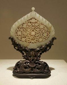 Mughal jade mirror back, 18/19th C, from the Palace Museum collection, Beijing, exhibited at the Art Museum of Chinese University in Hong Kong.