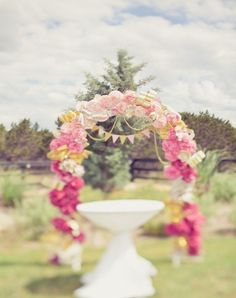 I love this arch. I'm going to use tissue paper pom poms in coral, peach, light pink. Maybe use lace bunting?
