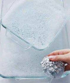 Use a wad of foil and dish soap to clean glass pans