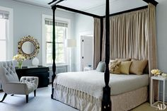 Painted in a Benjamin Moore gray, the master bedroom of this 1840s Manhattan townhouse was decorated by Christine Markatos Design.