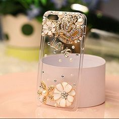 iPhone 6 Plus, 6 - Glitzy Gem Royal Crown & 3D Flower Bling on Clear Case  Item 1379  - Specialty: Simplicity with class blended together in clear case elegant bling!  Features:  - Brand: iPhone 6 Plus, 6 - Material: Protect in style with rubber case - Design: Rhinestone gem bling -